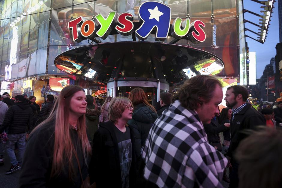 People walk past Toys R Us in Times Square the day after Christmas in the Manhattan borough of New York
