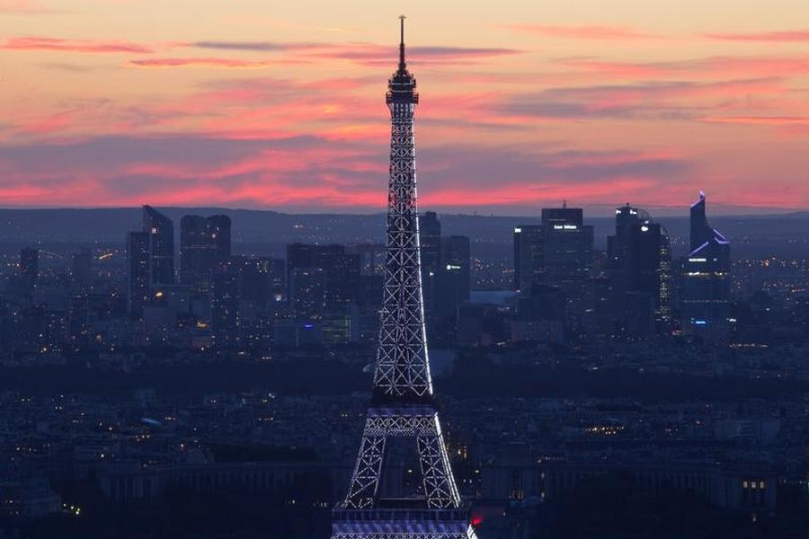 The Eiffel Tower and La Defense business district are seen during traditional Bastille Day in Paris