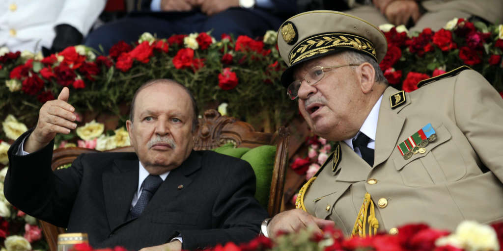 Algeria's President and head of the Armed Forces Abdelaziz Bouteflika gestures during a graduation ceremony of the 40th class of the trainee army officers at a Military Academy in Cherchell