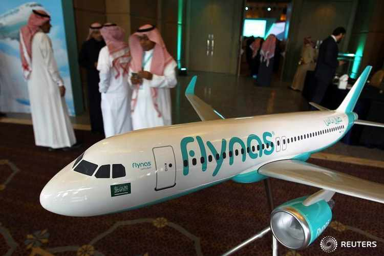 A model of Saudi airline Flynas is on display during a ceremony to sign a deal between Airbus and Flynas in Riyadh, Saudi Arabia January 16, 2017.